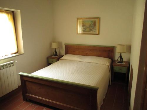 Katil atau katil-katil dalam bilik di Alloggio Laura in Residence Maremma