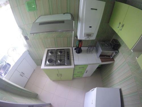 A kitchen or kitchenette at Almudena Apart Hotel