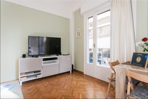 A television and/or entertainment center at Beautiful Apartment at Plaka