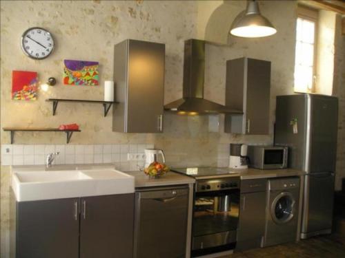 Kjøkken eller kjøkkenkrok på Apartment 2 rue de cinq ans: le grand