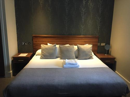 A bed or beds in a room at The Craibstone Suites