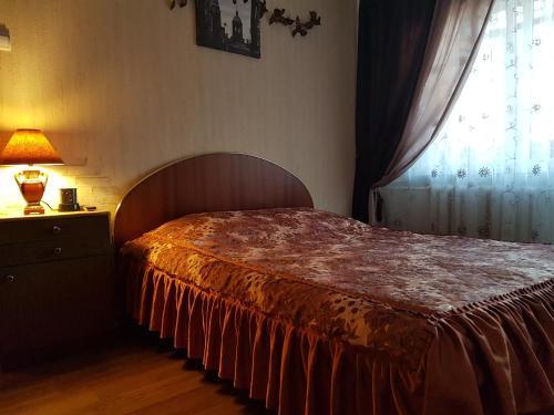 Кровать или кровати в номере ул.Патриаршая 17