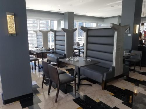 A restaurant or other place to eat at Affordable and Lux Apartment