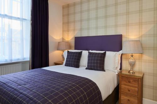 Ліжко або ліжка в номері Braid Apartments by Mansley