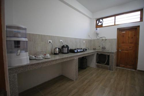 A kitchen or kitchenette at Karmaling Apartment