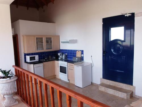 A kitchen or kitchenette at Pebble