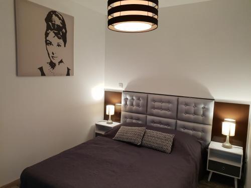 Un ou plusieurs lits dans un hébergement de l'établissement Les Lofts du Parc