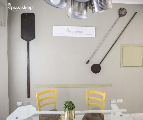 Letto o letti in una camera di PizzaSleep -apartment-