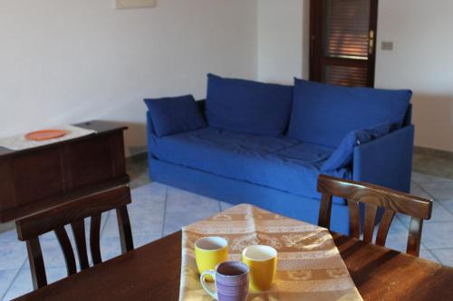 A seating area at Residence Oasi Blu