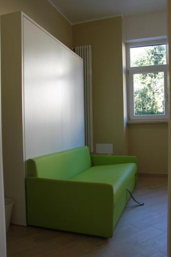 A seating area at Smart apartment Baggio Area