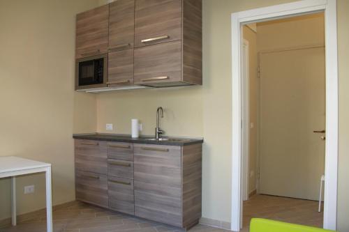 A kitchen or kitchenette at Smart apartment Baggio Area