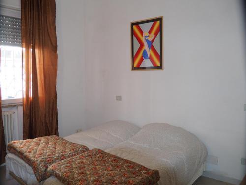 Кровать или кровати в номере Appartamento in Centro Storico, vicino alla Stazione e al Mare