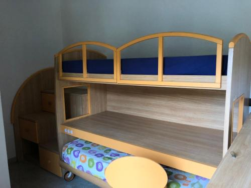 A bunk bed or bunk beds in a room at Appartamento Lidia
