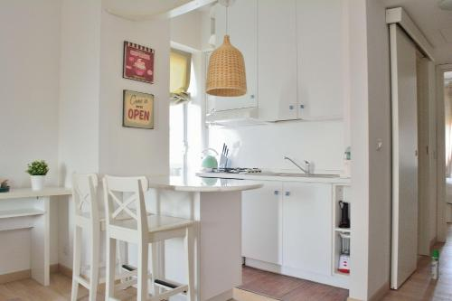 A kitchen or kitchenette at MariAnna's flat free wifi aircon