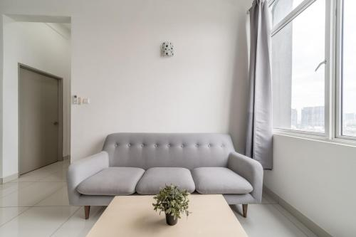A seating area at OYO Home 790 Premium 2BR Vue Residences