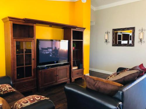 A television and/or entertainment center at Welcome To The Beautiful City