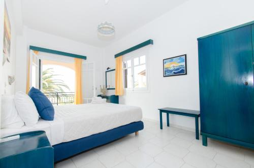 A bed or beds in a room at Natural Blue Green Apartment