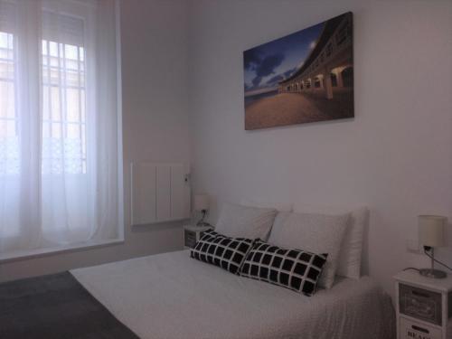 A bed or beds in a room at La Caleta de Cadiz