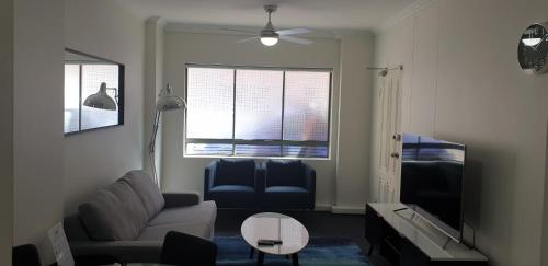 A seating area at Liv Arena Apartments Darling Harbour