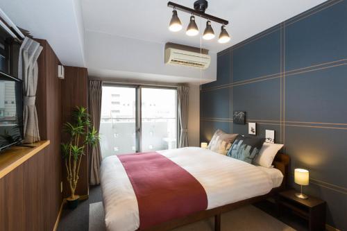 Residence Plus Nagasaki 1-3房間的床