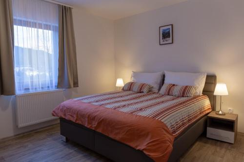 A bed or beds in a room at Apartmany Aneta