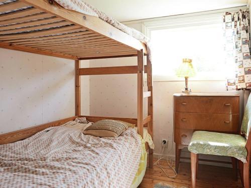Våningssäng eller våningssängar i ett rum på Holiday Home Lanna