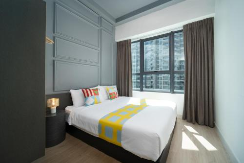 OYO Home 916 Elegant 2BR Arte Plusにあるベッド