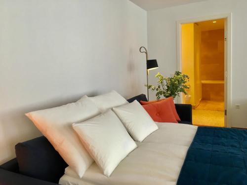 A bed or beds in a room at Quality Living - Heart of Copenhagen