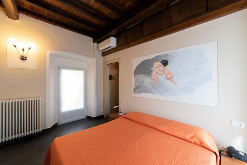 A bed or beds in a room at Residenza Pesce D'Oro