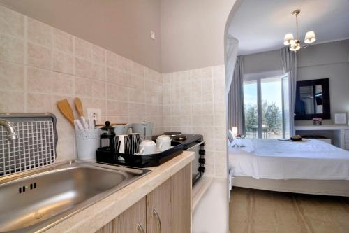 A kitchen or kitchenette at Corfu Sea View Rooms