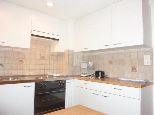 Cuisine ou kitchenette dans l'établissement Apartment Sonnenboden