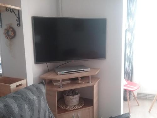A television and/or entertainment center at LA MORENA BLANCA