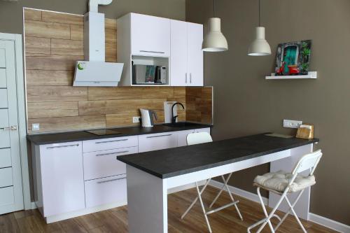 Кухня или мини-кухня в Business apartment complex