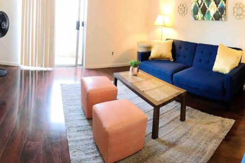 A seating area at 6 mins to Strip ENTIRE condo w/ FREE Parking WiFi