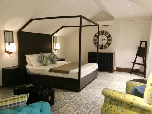 A bed or beds in a room at LUXURY GOA SKYVILLA at TREAS opp HILTON GOA RESORT with a Private Plunge Pool