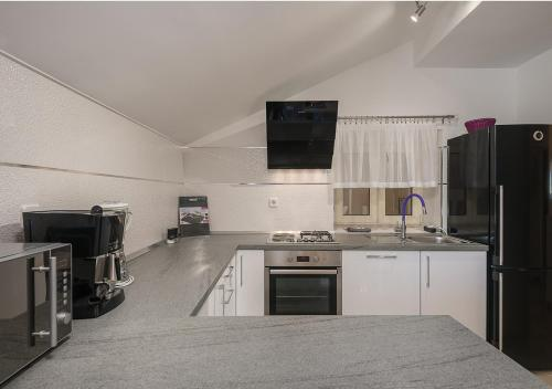 A kitchen or kitchenette at Adriatic Dream Apartments