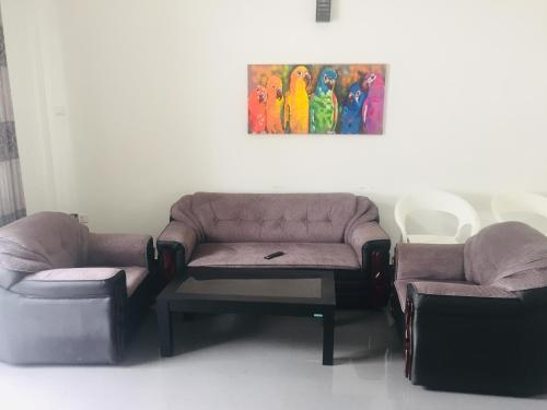 A seating area at Open Space Villa