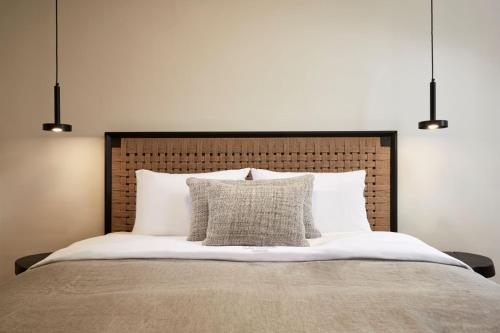 A bed or beds in a room at Loizos Stylish Residences