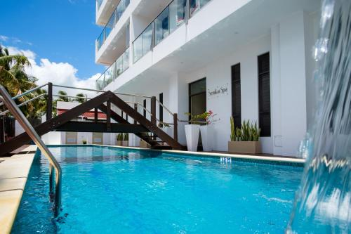 The swimming pool at or close to Ramada Suites by Wyndham Wailoaloa Beach Fiji