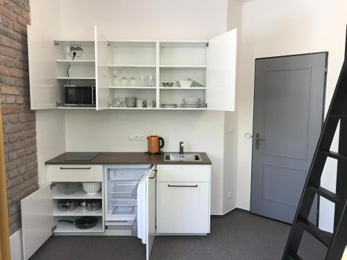 A kitchen or kitchenette at Prague Studios Andel