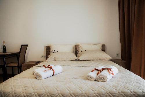 A bed or beds in a room at New Gudauri Loft II Apartment