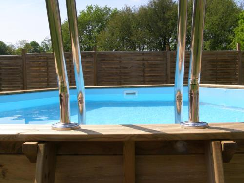 The swimming pool at or close to La Fortinerie Longere Farmhouse