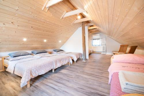 Postelja oz. postelje v sobi nastanitve Guest House Pr' Čut