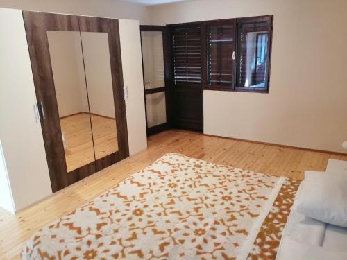 Cama o camas de una habitación en Paraiso Apartments & Rooms