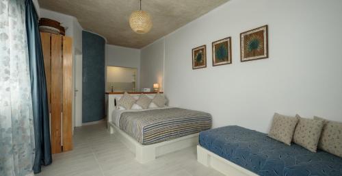 Cama o camas de una habitación en Vallas Apartments & Villas