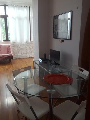 A television and/or entertainment center at Apartment in a Villa