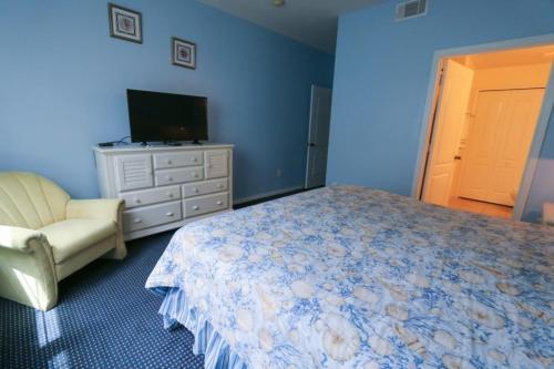 Un ou plusieurs lits dans un hébergement de l'établissement Runaway Beach Club Rab10103 Condo
