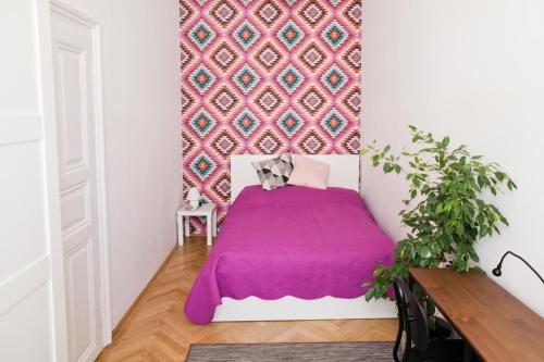 Ein Bett oder Betten in einem Zimmer der Unterkunft Twin Apartment