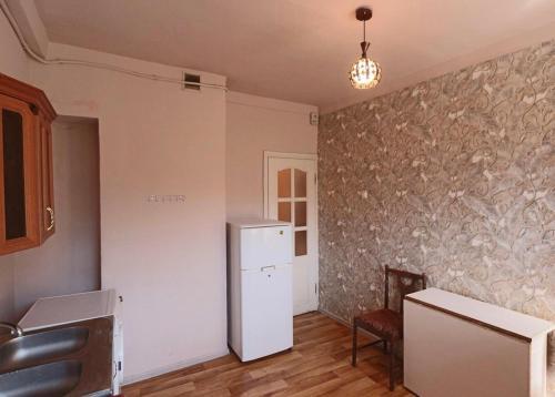 Кухня или мини-кухня в Comfortable Apartment in the centre