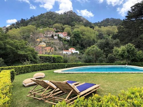 The swimming pool at or near Quinta dos Mouros